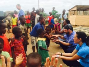 Students playing with kids Npinsi