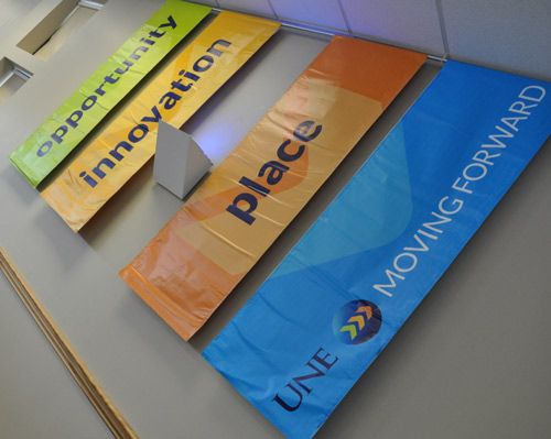 UNE Moving Forward banners