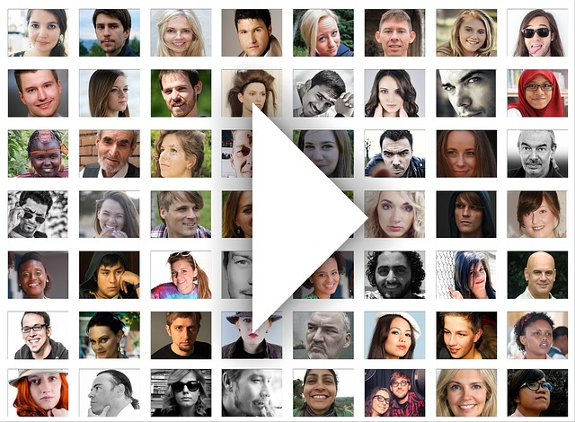 faces with a play button as in video