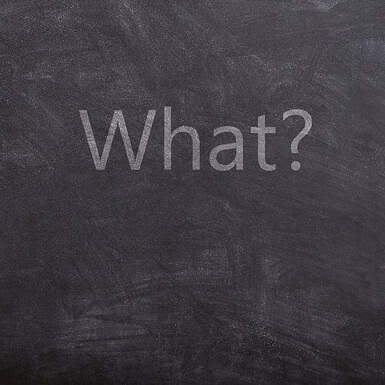 The word what with question mark written on blackboard