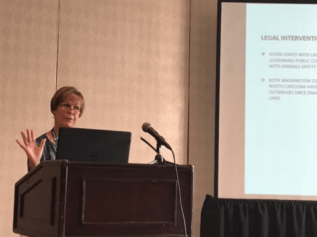 Margaret Linnell, DVM, MPH presenting her paper