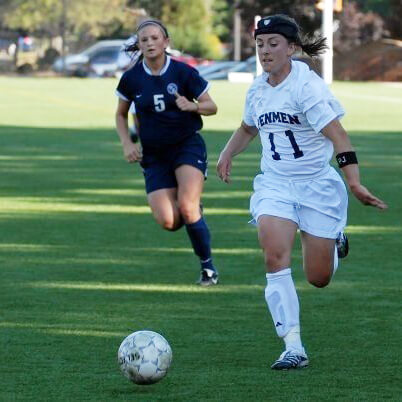 Laurie Boland (right) playing collegiate socce