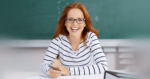 Teacher laughing as she undergoes supervision and evaluation