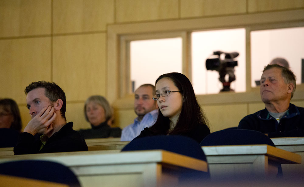 Student in a lecture hall at UNE