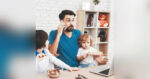 young dad working and homeschooling