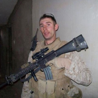 Kenneth Palmer, Independent Duty Corpsman, US Navy holding his service weapon