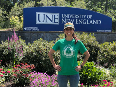 Jimmy Grattan, Master of Science in Applied Nutrition, in front of the UNE Biddeford campus